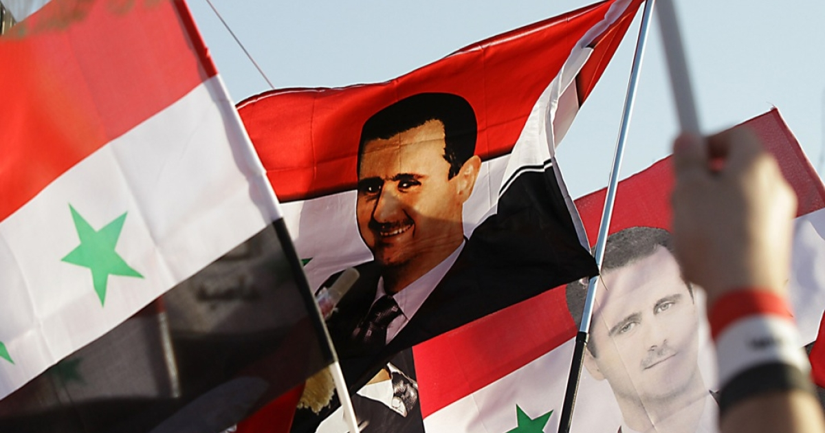 A depiction of Syrian President Bashar al-Assad on the country's national flag.</p>