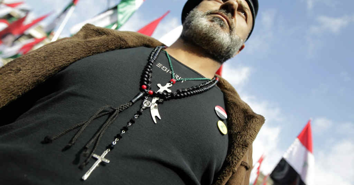 A Syrian supporter of President Bashar Assad wears a Christian rosary, Sunni praying beads and a Shiite Imam Ali sword around his neck.  But the days of the Arab Spring are long gone, as the war in Syria has turned into a Sunni vs. Shiite rivalry.</p>