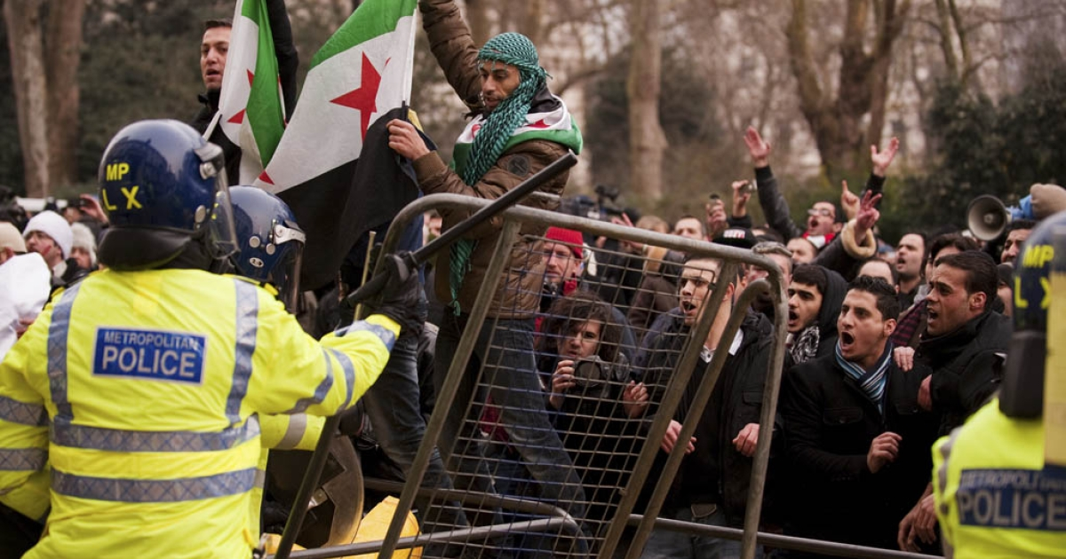 Protesters clash with police outside the Syrian embassy in London on Saturday in reaction to a failed UN Security Council vote and reports of civilian deaths in Homs.</p>