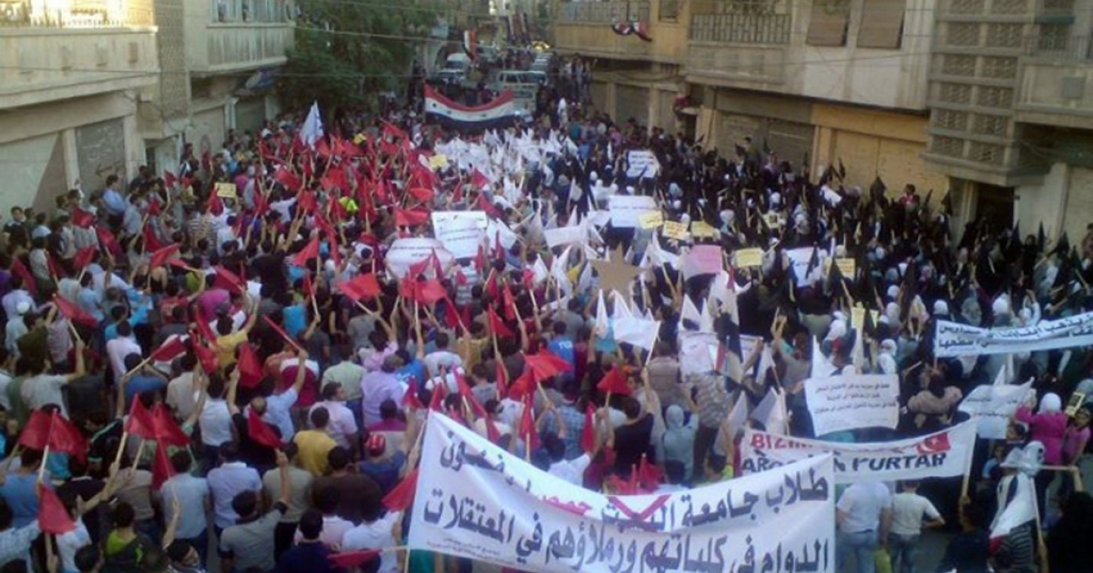 Protestors march in Homs, which is suffering a sustained military assault. With the UN Security Council unable to act against the Assad regime's deadly crackdown, increasing numbers of protestors warn taking up arms may be their only option.</p>