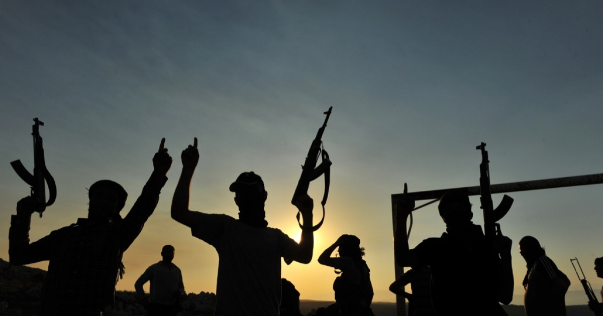 Members of Jihadist group Hamza Abdualmuttalib train near Aleppo on July 19, 2012.</p>