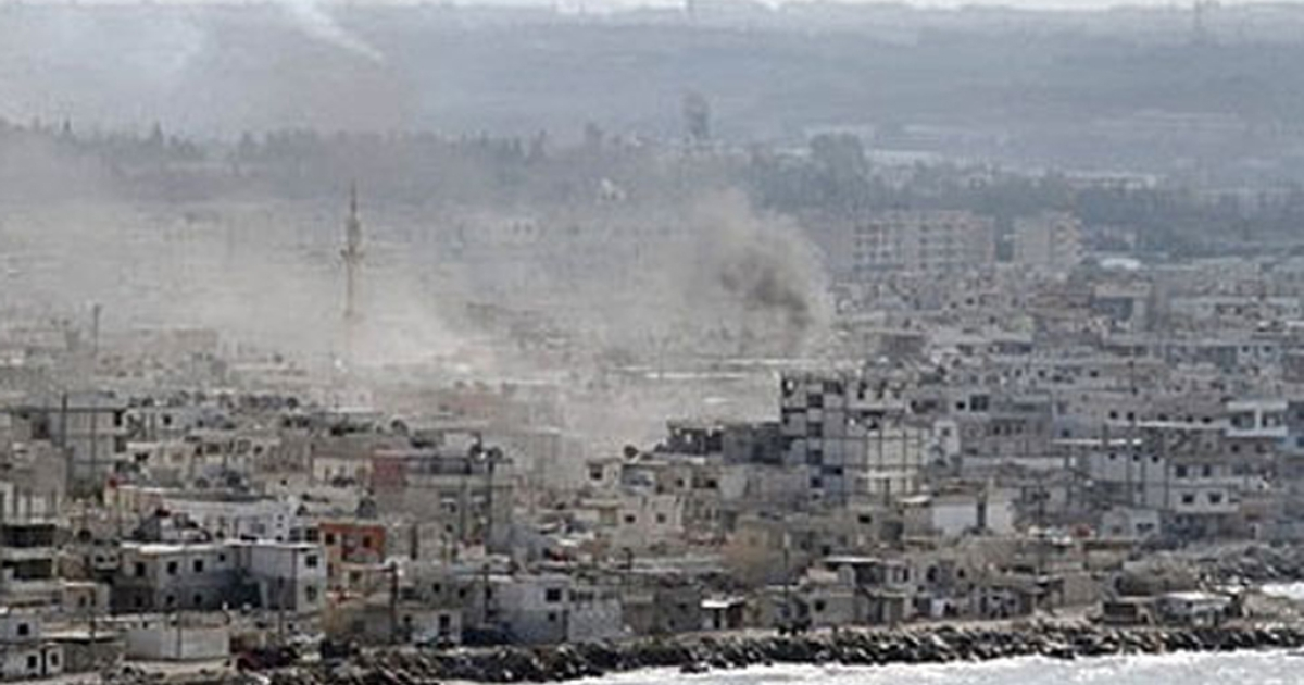 Smoke rises over Latakia, Syria, which was pummeled by Syrian tanks and navy gunboats trying to crush protests.</p>