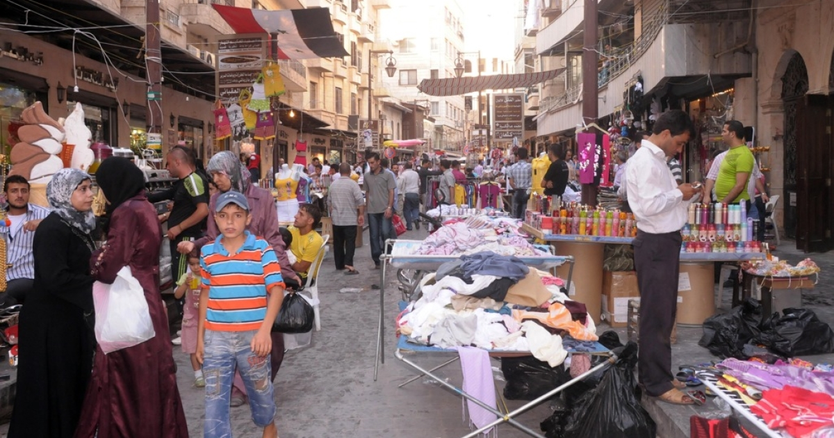 This file photo from August 20, 2011, shows traders, shops and stalls in the area of the medieval souk in the city of Aleppo in northern Syria. The ancient market, recognized by UNESCO as a world heritage site, was badly damaged by a blaze that started on September 28, 2012, destroying much of the souk as rebel forces clashed with Syrian government troops.</p>