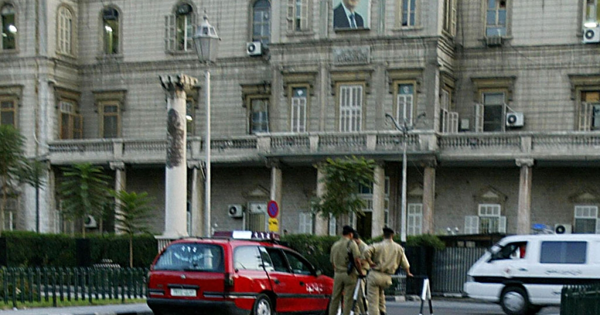 Policemen guard the Interior Ministry headquarters in Damascus, Syria, in this 2005 file photo.</p>