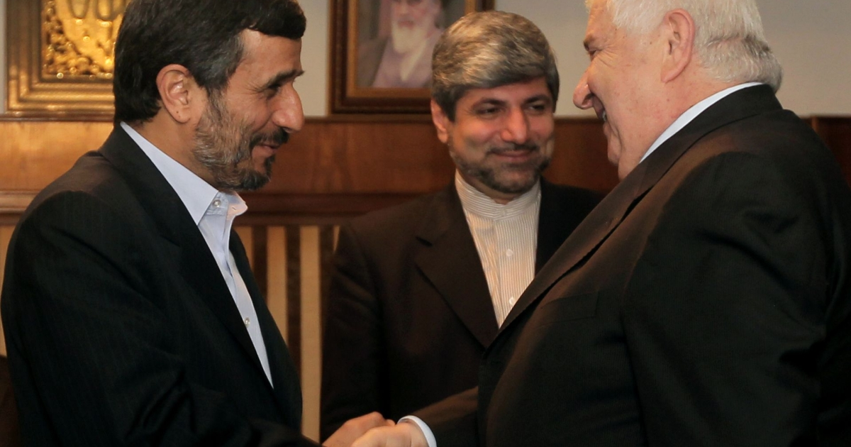 Syria's Foreign Minister Walid Muallem (R) shakes hands with Iranian President Mahmoud Ahmadinejad on the sidelines of the a two-day nuclear disarmament conference in Tehran on Apr. 17, 2010. Iran slammed
