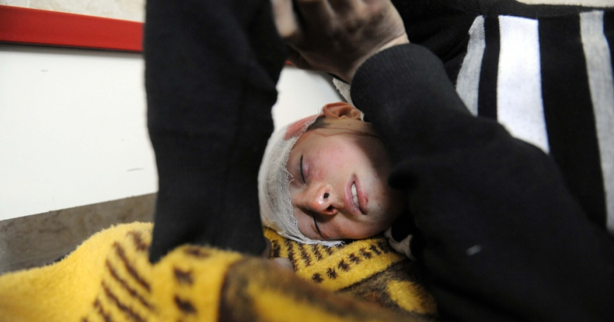 A Syrian youth recovers at a hospital in Idlib in northwestern Syria on February 24, 2012 after he was wounded in an attack amid the regime's deadly crackdown on dissent.</p>