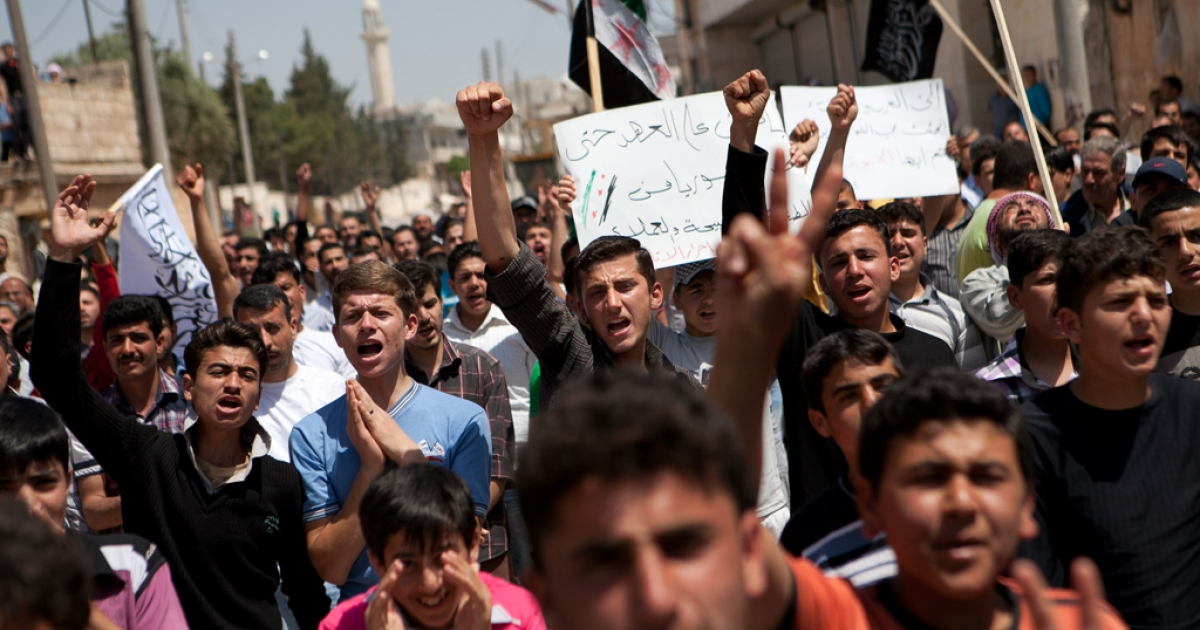 Syrian protesters shout slogans during an anti-regime demonstration in the town of Atareb, 30km west of Aleppo, on April 27, 2012. Tens of thousands protested across Syria as a deadly suicide bombing rocked the capital, killing 11 people and fueling growing skepticism over the prospects of a UN-backed peace plan.</p>