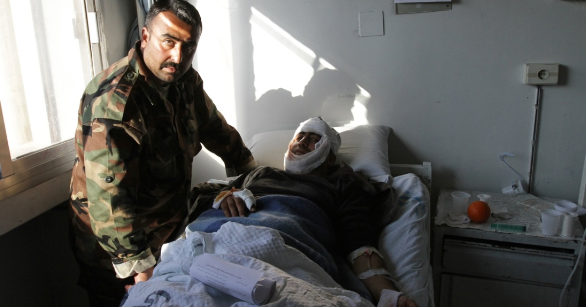 A Syrian man who was wounded in an earlier suicide attack on Dec. 23 rests at a hospital in Damascus.</p>