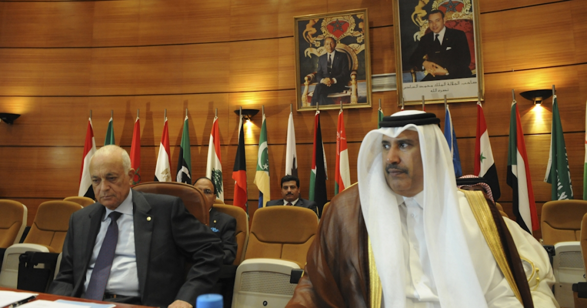 Qatari foreign minister Cheikh Hamed Ben Gassem (R) and Secretary General of Arab League Nabil al-Arabi (L) during a meeting comprising of Arab league Member states and Turkey to discuss a response to the crackdown in Syria, in Rabat on November 16, 2011. Syrian President Bashar al-Assad's regime will pay dearly for the deadly crackdown it has unleashed on its own people, Turkish Foreign Minister Ahmet Davutoglu said.'The Syrian regime is going to pay very dearly for what it has done,' Davutoglu told journalists in Rabat, where Arab League ministers are to discuss sanctions against the Damascus regime.</p>