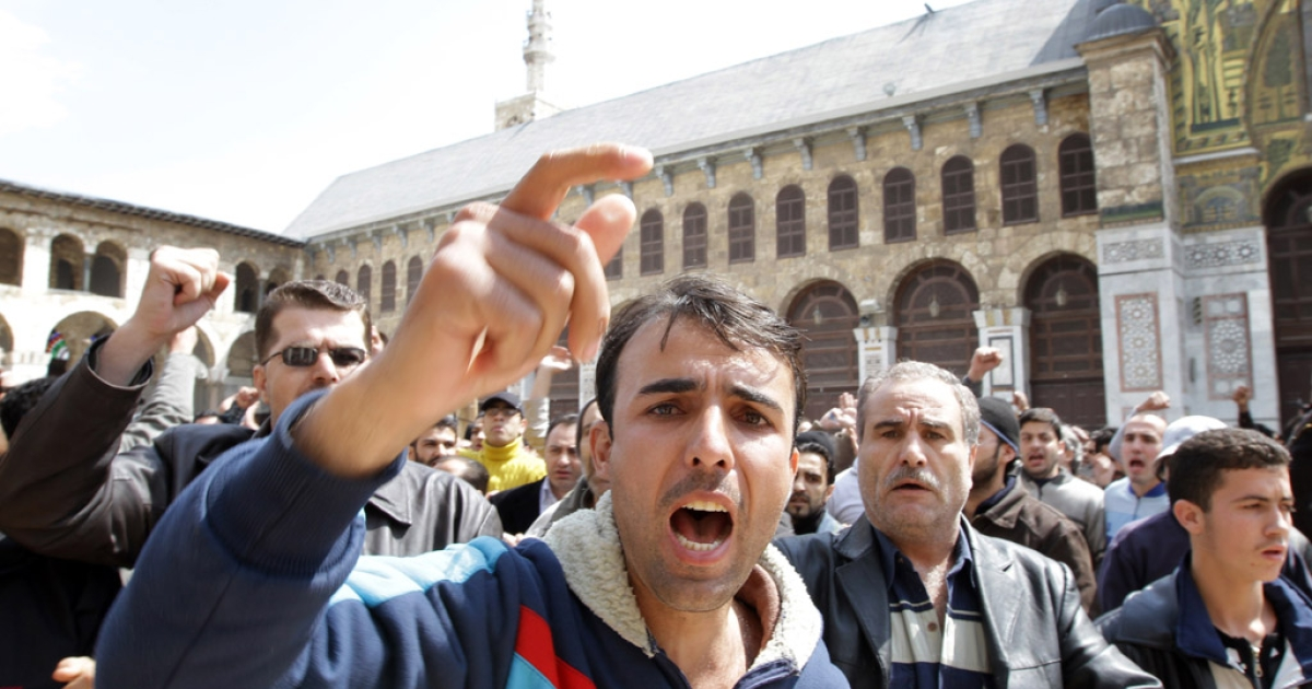 Hundreds of Syrians march from the Omayyed mosque in the centre of Damascus' Old City towards Souk Al-Hamadiyeh street on March 25, 2011 chanting