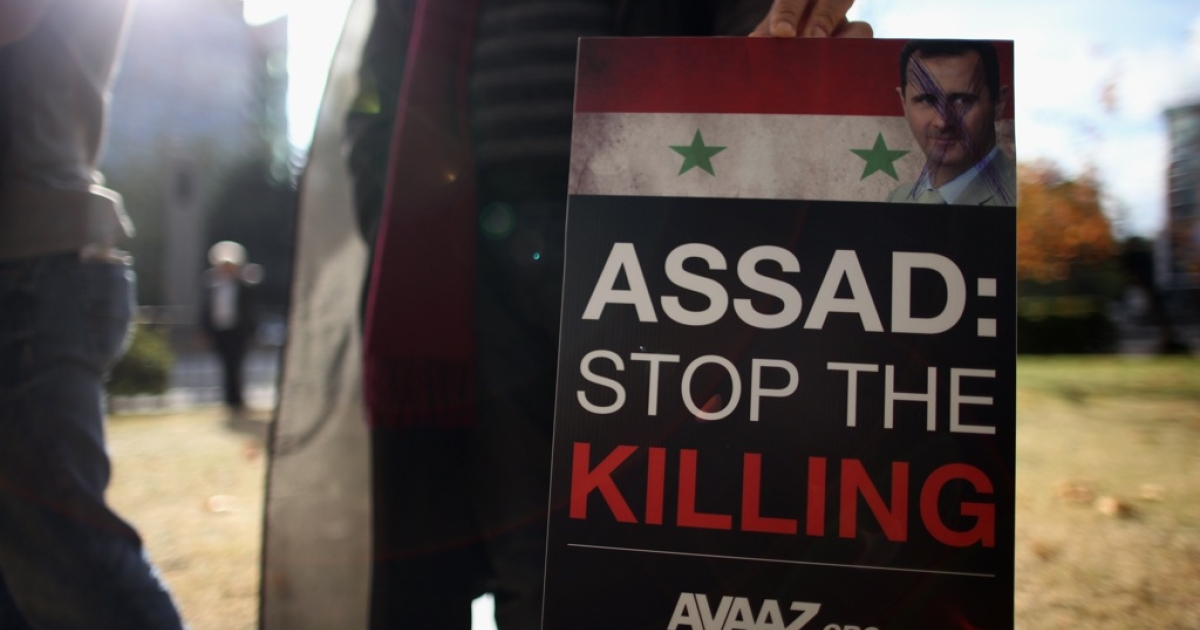 Syrian protesters make their way down Edgeware Road to the Syrian Embassy on October 29, 2011 in London, England. Amnesty International activists and Syrians living in the UK are to hold a 'No More Blood - No More Fear' rally outside the Syrian embassy to call for an end to the government crackdown in Syria, which has killed at least 3,000 people.</p>
