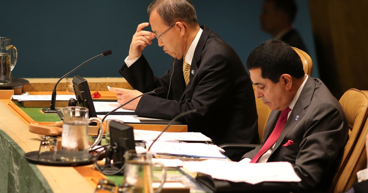 United Nations Secretary General Ban Ki-moon listens as Bashar Ja'afari, Syria's ambassador to the United Nations, addresses the U.N. General Assembly on September 4, 2012 in New York City.</p>