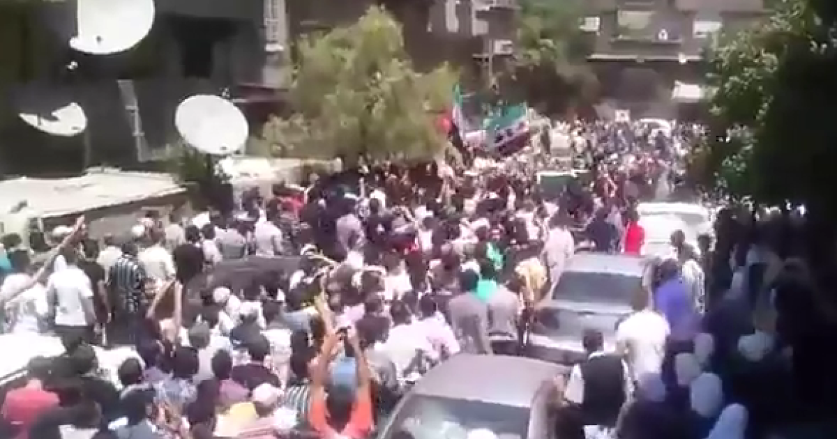 A screenshot of one YouTube video reportedly showing a Damascus funeral that draws a large anti Assad crowd in the Al Moazzini neighborhood. This is reportedly the funeral of Mohammed Loay Al Halabi who was killed by the Assad regime. Video taken July 18, 2012.</p>