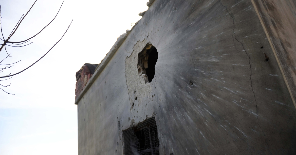 A house hit by a shell which activists say was fired by Syrian regime forces in Idlib in northwestern Syria on February 22, 2012, the day two foreign journalists were killed as Syrian forces pounded the rebel city of Homs.</p>