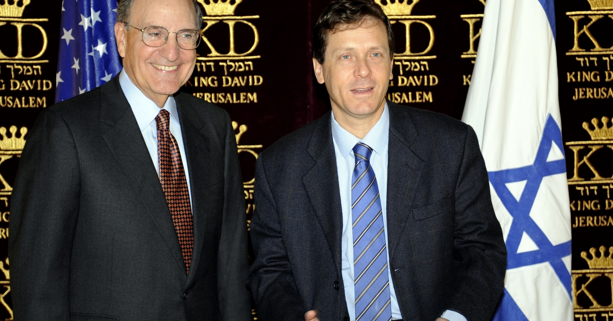 Isaac Herzog, then the Israeli minister of social welfare, right, greets US Special Middle East Envoy George Mitchell in 2009 in Jerusalem.</p>