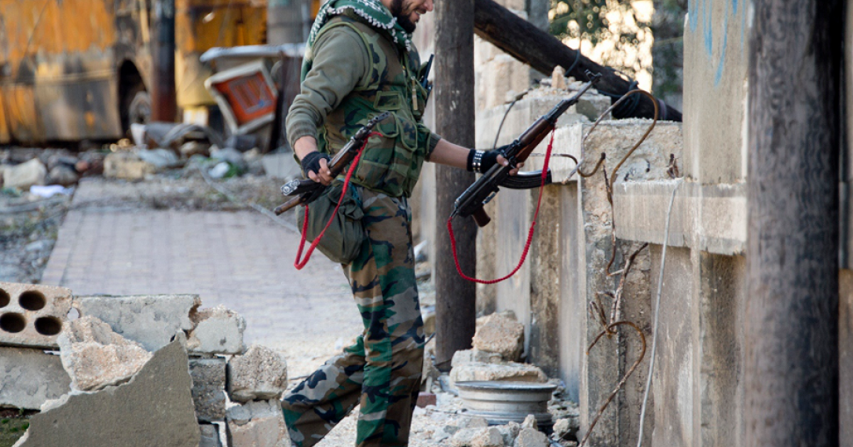 A Syrian rebel fighter in the Aleppo neighborhood of Bustan al-Basr on Dec. 8, 2012.</p>