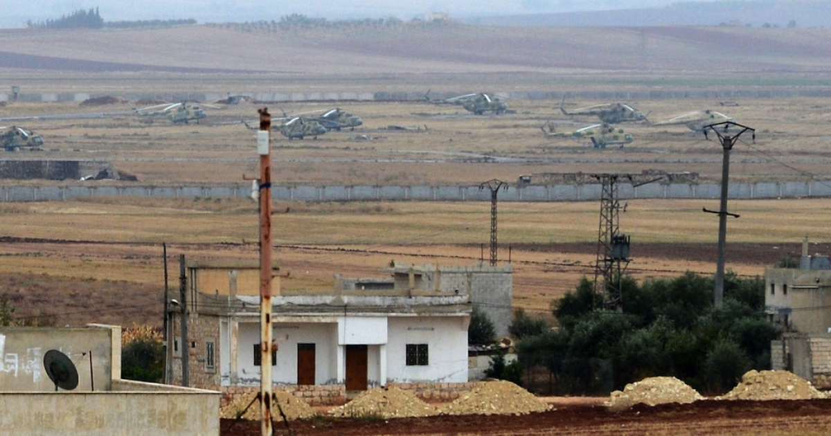 Syrian government forces' helicopters are parked at a military base near the northern Syrian town of Taftanaz, in the Idlib province, on Nov. 9, 2012.</p>