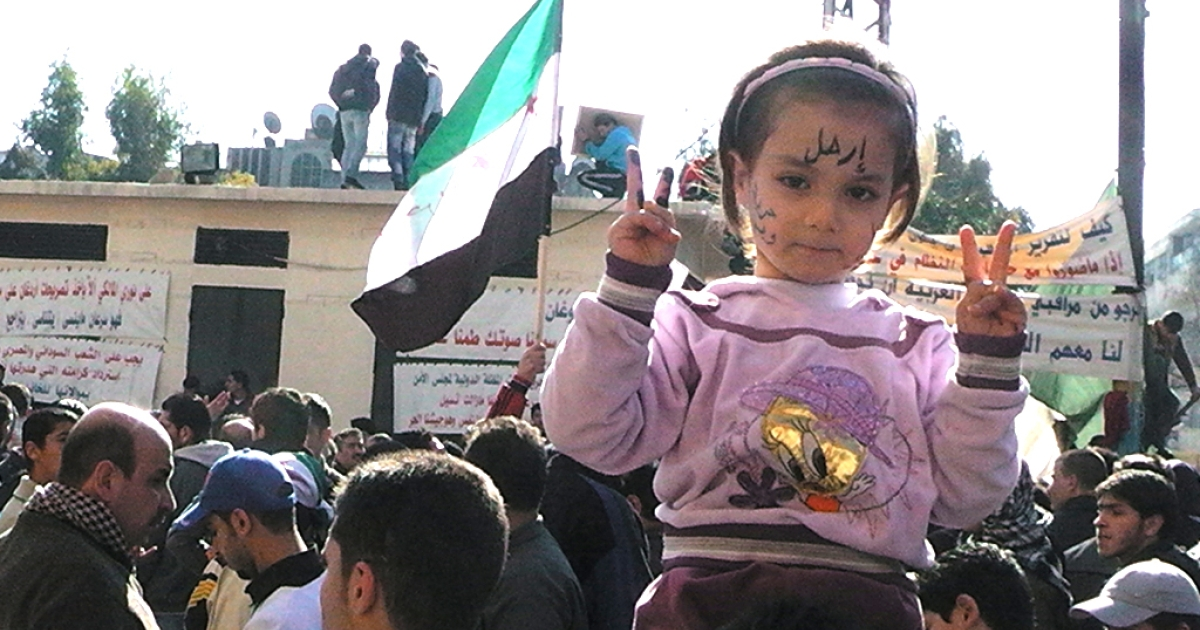 A Syrian girl gestures during a protest in the flashpoint city of Homs on February 3, 2012. At least 17 people, two of them children and nine of them government troops, were killed in violence across Syria, the Syrian Observatory for Human Rights said.<br />AFP PHOTO/STR (Photo credit should read -/AFP/Getty Images)</p>