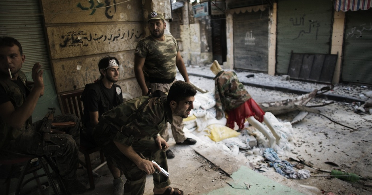 Free Syria Army fighters man a position in the city of Aleppo on Sept. 16, 2012. More than 27,000 people have been killed since the uprising against President Bashar al-Assad's rule erupted in March last year, the Britain-based Observatory estimates. The United Nations puts the toll at 20,000.</p>