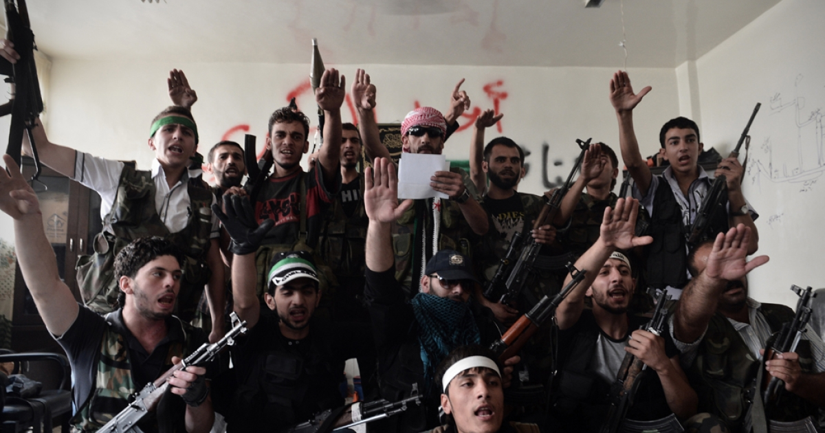 Syrian opposition fighters swear for the liberation of Syria at an undisclosed location in the northern city of Aleppo on August 29, 2012. The battle for Aleppo, Syria's second largest city, has lasted for over a month, with the government forces unable to dislodge the rebels.</p>