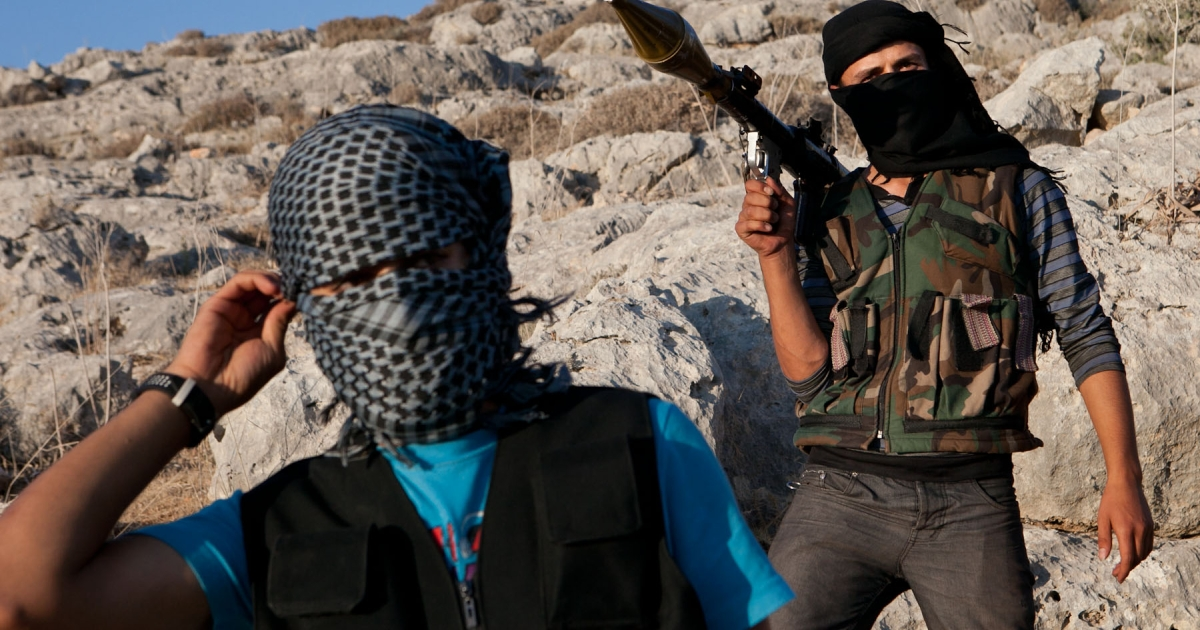Fighters loyal to the Free Syrian Army (FSA) pose with their weapons in a location on the outskirts of Idlib. Weapons and other supplies are obtained using money raised by internet networks.</p>