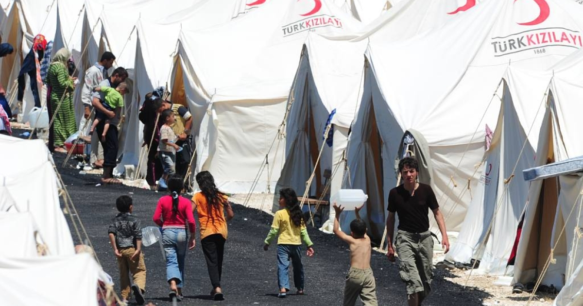 "Syrian refugees at the Boynuyogun Turkish Red Crescent refugee camp in the Altinozu district of Hatay, near the Syrian border. Thousands of Syrian civilians have fled to Turkey from the region after Syria's army began operations to ""restore security"" near the Turkish border.</p>"