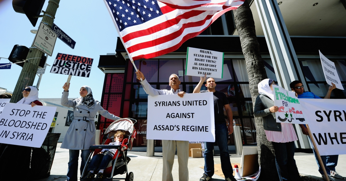 Protesters in June demonstrate against the Syrian regime in front of CNN offices in Los Angeles.</p>