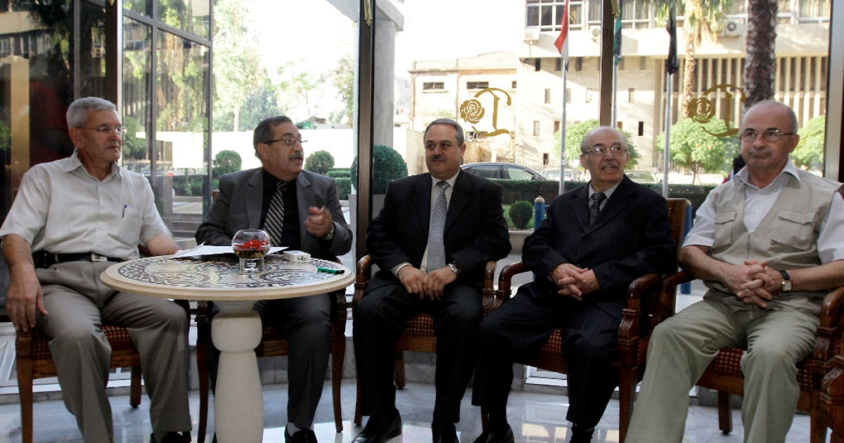 Representatives of the Syrian opposition tolerated by the regime (L-R) Akram Akrami, Raja Nasser, Mahmud Marei, Hassan Abdel Azim and Mahmud Said Rassas wait to meet with international envoy Lakhdar Brahimi in Damascus on September 14, 2012. Brahimi also met Syrian opposition figures whom said he were bringing 'new ideas' to peace efforts as blasts rocked Damascus.</p>