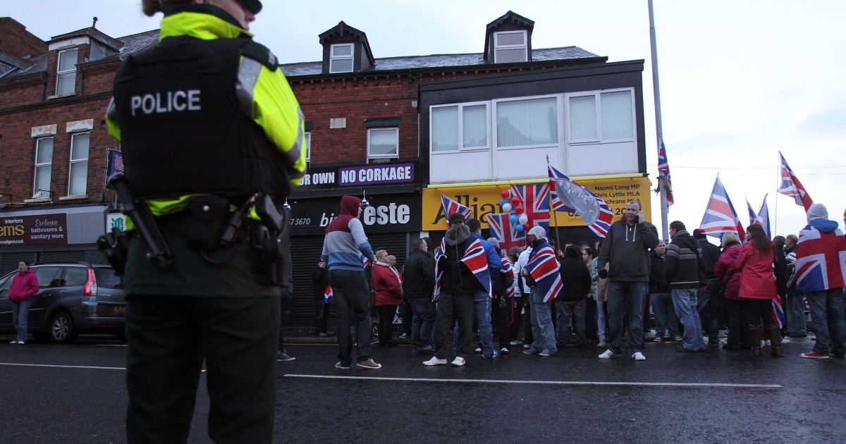 About 100 loyalists protest outside an Alliance Party office in east Belfast, Northern Ireland, on December 4, 2012 after city councillors voted not to fly the British flag all year round, police said.</p>