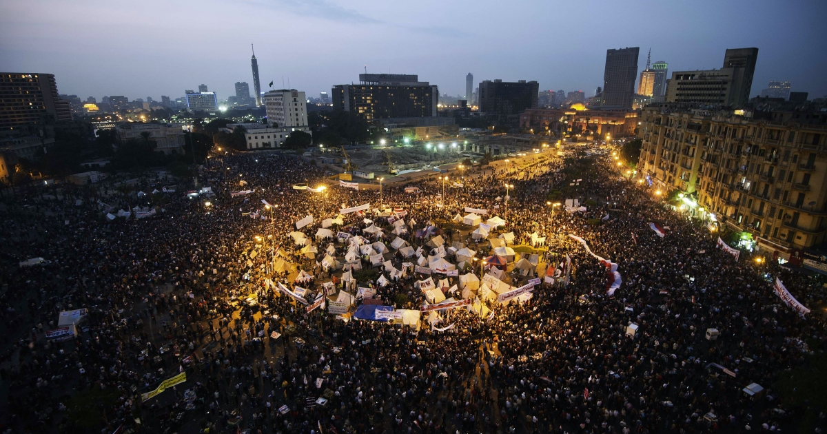 Tens of thousands people take part in a mass rally against a decree by President Mohamed Morsi granting himself broad powers on November 27, 2012 at Egypt's landmark Tahir Square in Cairo. Egyptians face a grim choice between an Islamist constitution and a return to dictatorship.</p>
