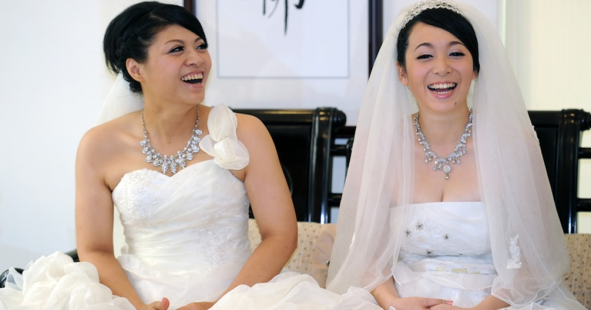 Huang Mei-yu (L) and her partner You Ya-ting smiling during their same-sex Buddhist wedding ceremony. A Buddhist cleric's decision to wed two women in Taiwan is the latest sign that obstacles to same-sex unions are quietly coming down in Asia, with religion posing less of a hindrance than in the west.</p>