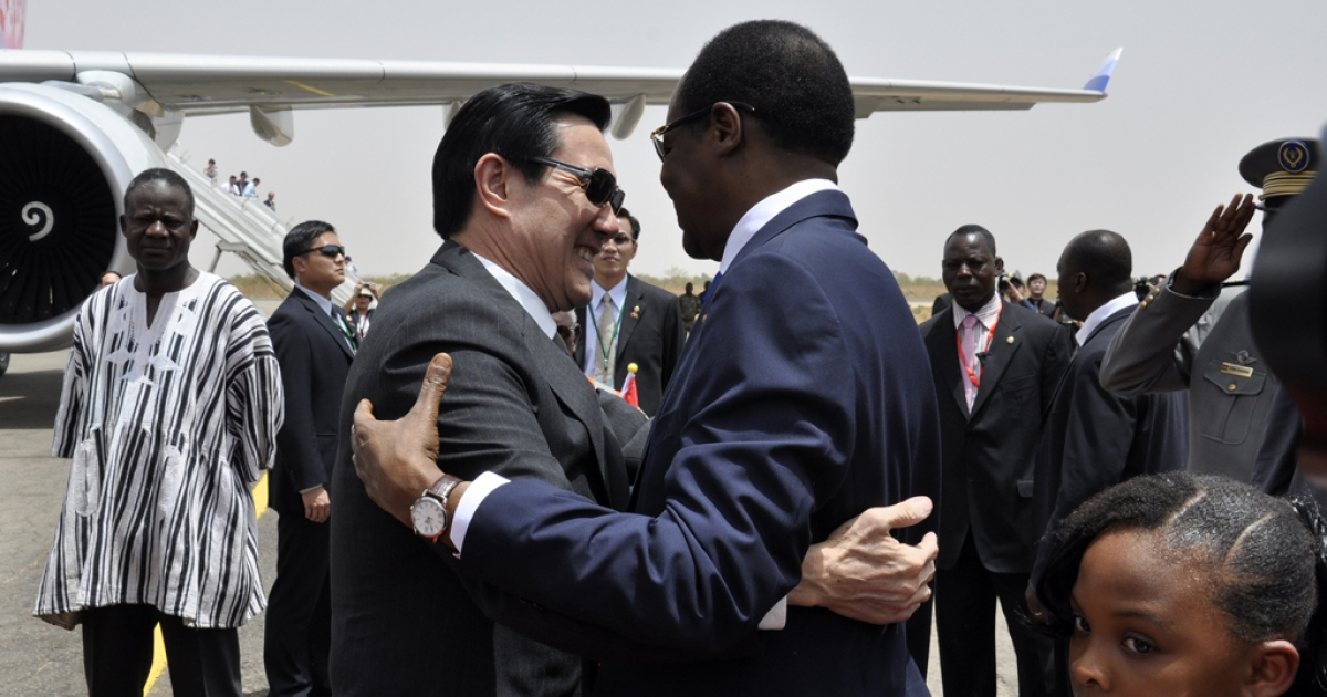Taiwan's President Ma Ying-jeou is embraced by President of Burkina Faso Blaise Compaore as he arrives in Ouagadougo on April 8, 2012. Ma was on a three-leg trip to Burkina Faso, Gambia and Swaziland.</p>