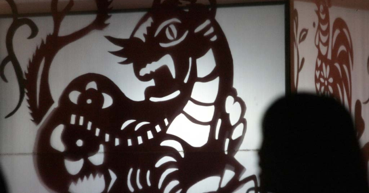 A tiger lantern for the 2010 Taipei Lantern Festival, Feb. 24, 2010. Aside from running the country's trade in drugs, illicit weapons, prostitution and illegal gambling, Taiwan's gangsters also attempt to influence political and religious life.</p>