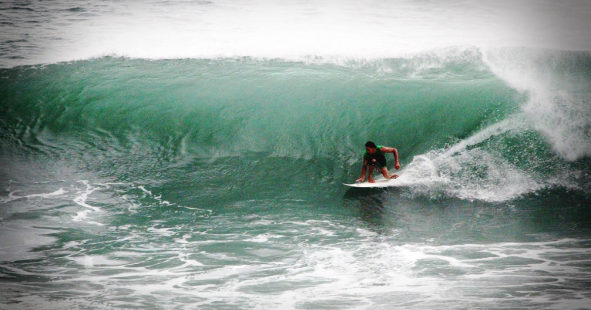 Taiwanese surfer catches a pre-typhoon swell in the Pacific Ocean.</p>