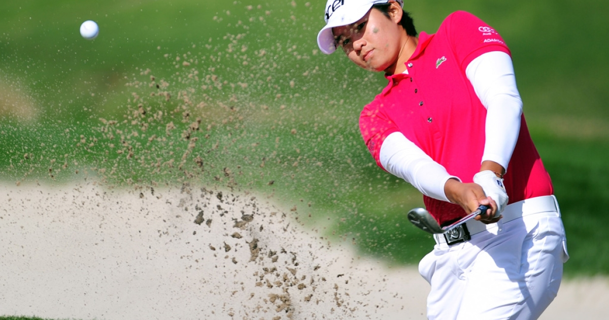 Yani Tseng of Taiwan at the first hole during the fourth round of the Kia Classic at the La Costa Resort and Spa on March 25, 2012 in Carlsbad, Calif.</p>