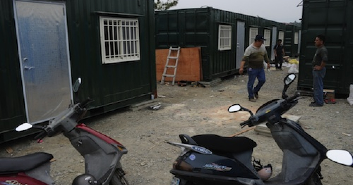 Workers modify freight containers being converted into shelters for alleged cult members in Taiwan. Dozens of Taiwanese have reportedly rushed to prepare makeshift shelters in central Taiwan after the man, known only as 'Teacher Wang', alleged that a huge earthquake and tsunami would destroy the island next month.</p>