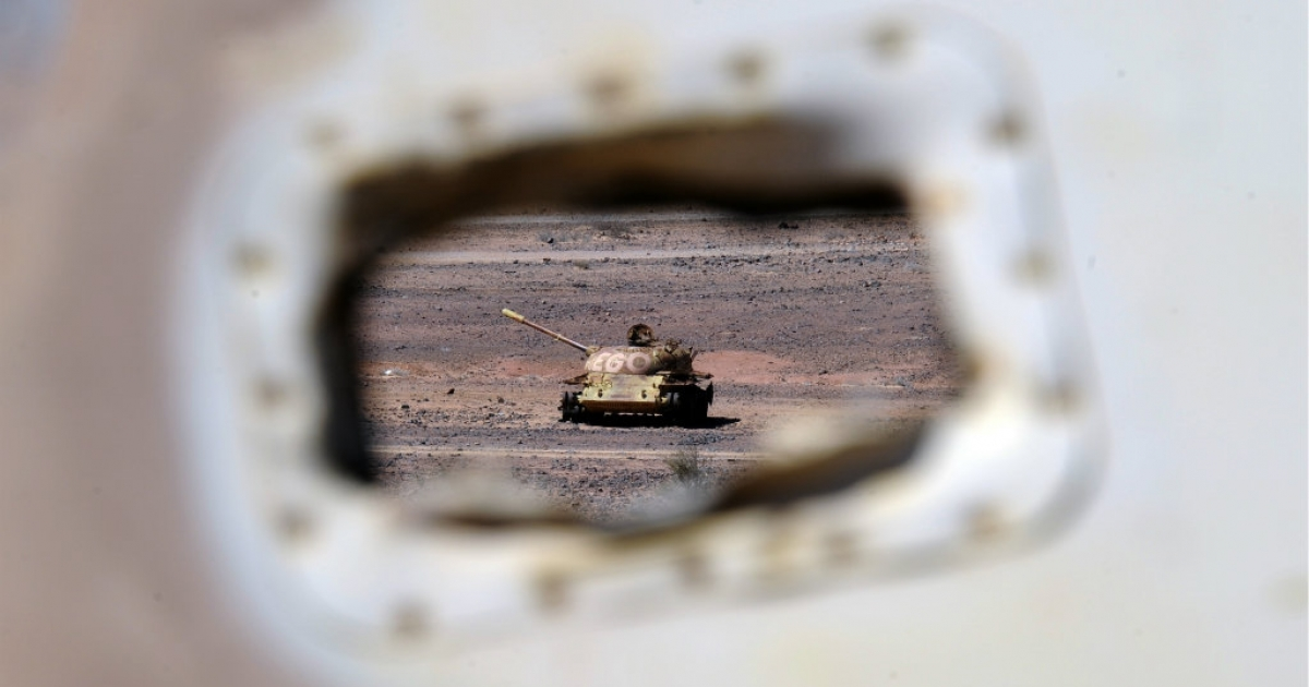 The wreckage of a Morrocan tank is pictured near the Western Sahara village of Tifariti. Western Sahara is a former Spanish colony which was annexed in 1975 by Morocco. The Polisario Front, backed by Algeria, wants independence for the territory on the west African coast.</p>