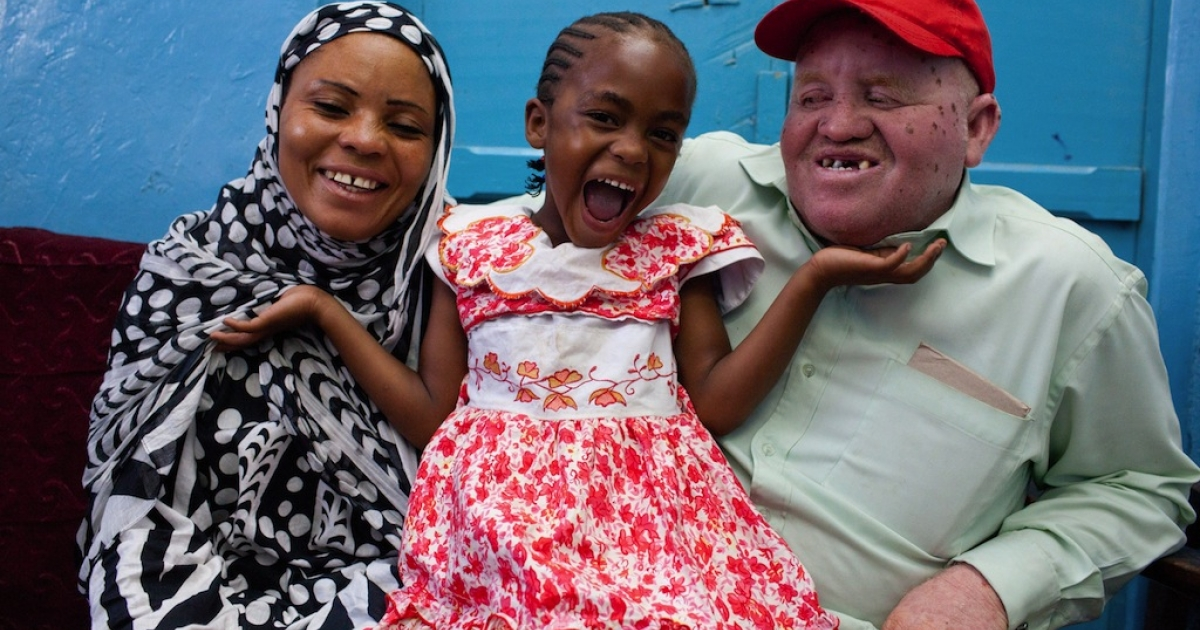 Tanzania's first elected albino lawmaker Salum Khalfan Barwany (R) smiles as he poses with his wife Fatuma (L) and their 6-year-old daughter Shuweikha (C) in the southeastern Tanzanian town of Lindi on Nov. 4, 2010.</p>