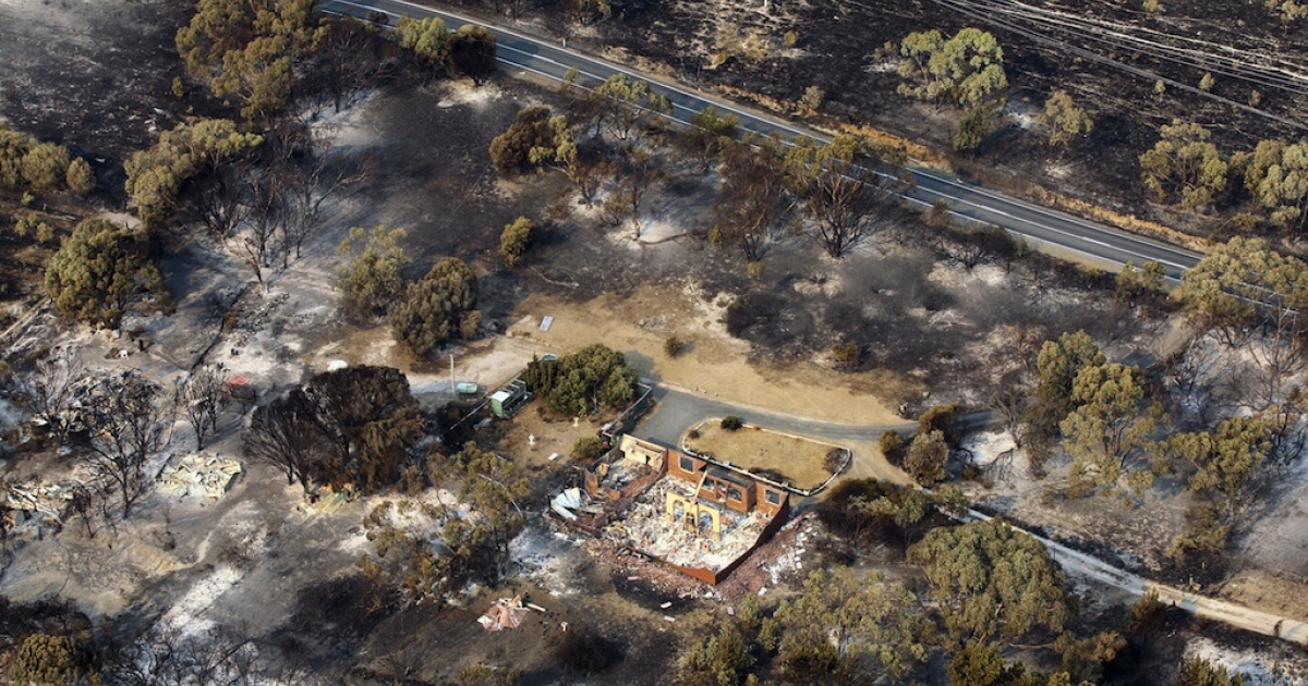 This aerial photograph taken on January 5 shows the devastation to property between Dunalley and Boomer Bay after wildfires swept through the area.</p>