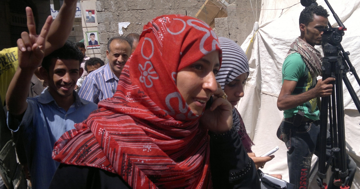 Yemeni Tawakkul Karman, one of the three women awarded the Nobel Peace Prize on October 7, 2011, speaks on the phone as she leaves her protest tent encampment in Sanaa, following the announcement that she was a laureate.</p>