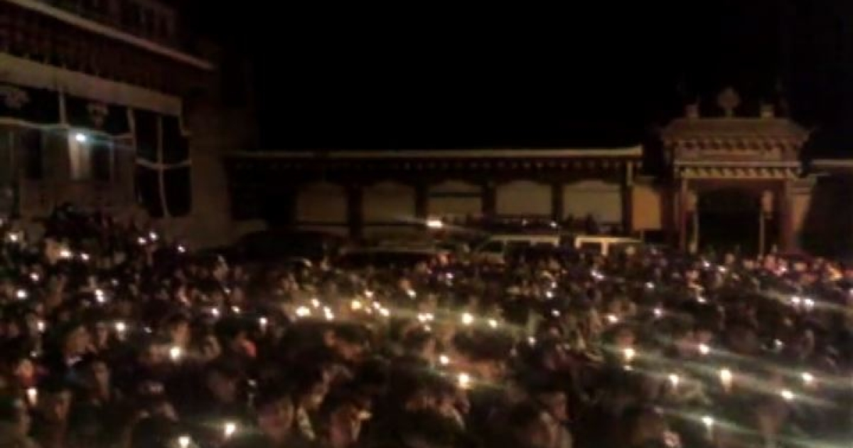 An activist group says 10,000 Tibetans gathered for a candlelit vigil after a nun set herself on fire to protest Chinese policies earlier this month.</p>