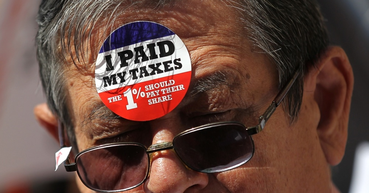 A protestor during a tax day demonstration on April 17, 2012 in New York City. Protesters demonstrated against loopholes allowing corporations to pay lower income taxes than most individuals. So where does all that money go anyway?</p>