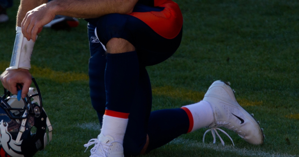 Four Long Island high school students were suspended for mimicking Tim Tebow's prayer pose and causing a frenzy in the school hallways.</p>