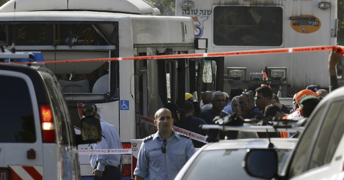 Israeli police seal off the area surrounding the bus which was hit by a bomb near the defence ministry in Tel Aviv on November 21, 2012. At least 10 people were injured in an explosion on a bus, Israel's emergency services said, in what an official said was
