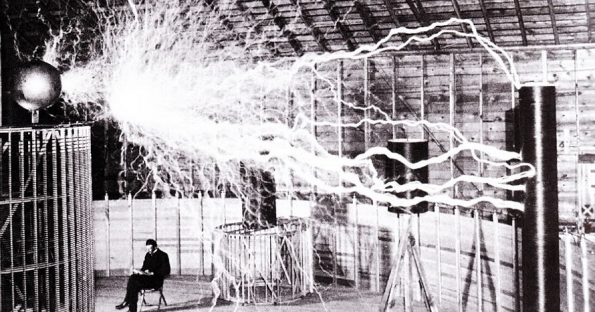 Publicity photo of Nikola Tesla sitting in his laboratory in Colorado Springs in December 1899, the same year the laboratory was built. The photo was taken by Dickenson V. Alley, photographer at the Century Magazines. Tesla sent a copy of this photograph to Sir William Crookes in England in 1901.</p>