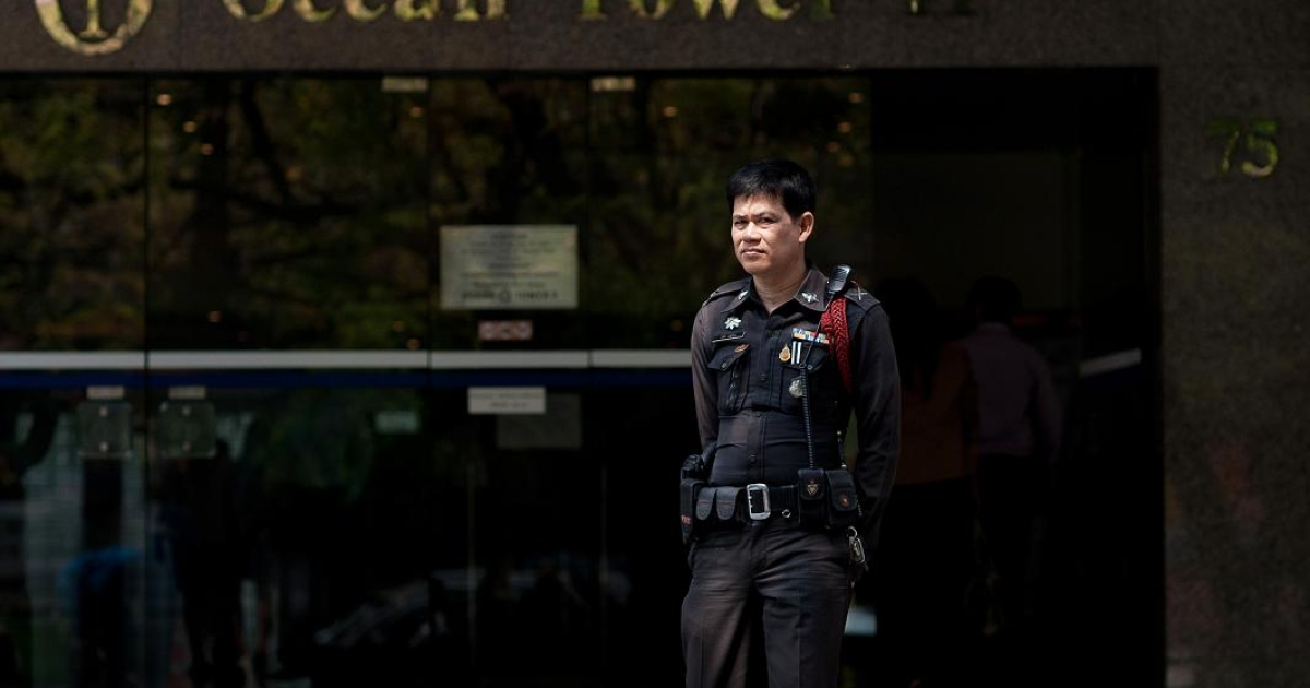 A Thai police officer stands guard outside the Israeli embassy building in Bangkok, a day after multiple explosions rocked the Thai capital.</p>