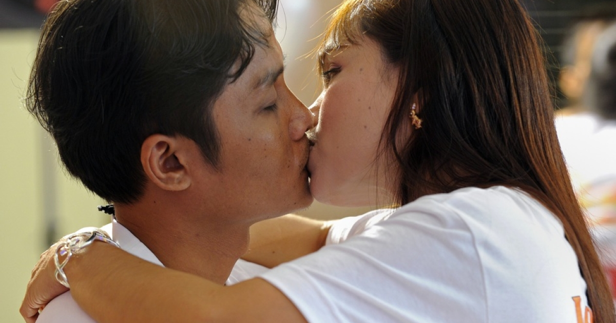 A Thai couple kisses during a competition for the 'World's Longest Continous Kiss