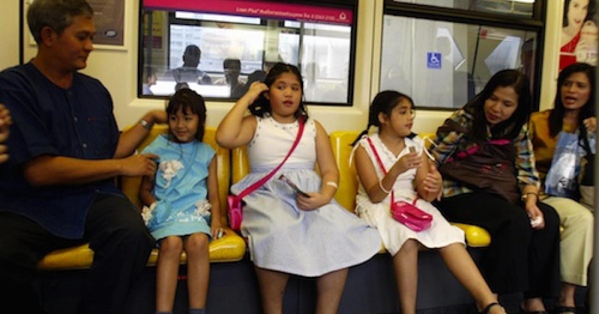 A family rides Bangkok's elevated