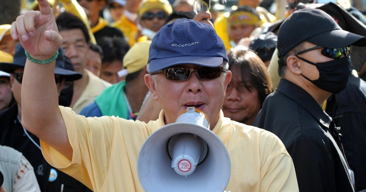 Thai Yellow Shirt leader Sondhi Limthongkul speaks during a protest in front of Parliament in Bangkok on Nov. 24, 2008. He has just been sentenced to 20 years in prison for corporate fraud, but says he will appeal.</p>
