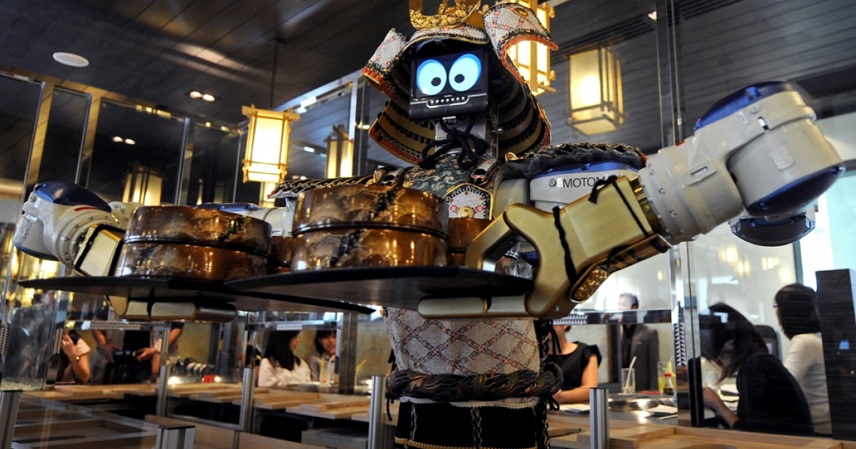 A robot waiter holds a tray of food at a Japanese robot restaurant in Bangkok on April 1, 2010.</p>